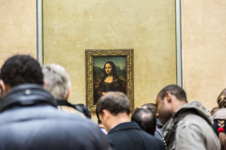 priceless: PARIS - AUGUST 4: Visitors take photo of Leonardo DaVincis Mona Lisa at the Louvre Museum, August 4, 2013 in Paris, France. The painting is one of the worlds most famous. Editorial