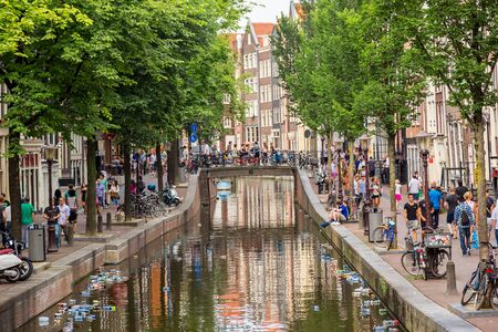 red light district: AMSTERDAM, NETHERLANDS - AUGUST 19: Red light district in Amsterdam. Amsterdam is the capital and most populous city of the Netherlands on August 19, 2014