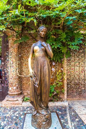 juliets: Bronze statue of Juliet in a summer day in Verona, Italy