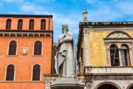 dante alighieri: Statue of Dante Alighieri in a summer day in Verona, Italy Stock Photo
