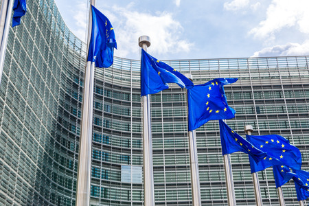 international crisis: European flags in front of  headquarters of European commission in Brussels in summer day