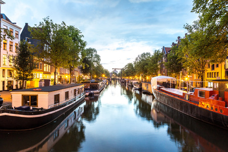 Canals of Amsterdam at night. Amsterdam is the capital and most populous city of the Netherlands Stock Photo