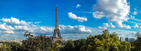 Panorama of the Eiffel Tower in Paris, France in a beautiful summer day photo