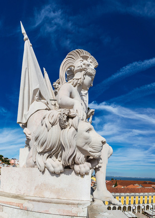 Statue on triumphal augusta arch in Lisbon in a beautiful summer day photo
