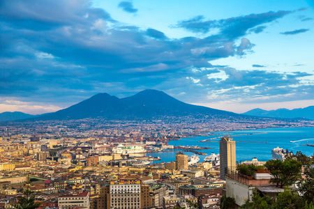 italy background: Napoli (Naples) and mount Vesuvius in the background at sunset in a summer day, Italy, Campania