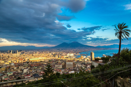 Napoli (Naples) and mount Vesuvius in the background at sunset in a summer day, Italy, Campania photo