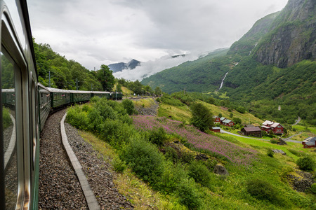 Train at famous Flam railway (Flamsbana) line in Flam valley in Norway