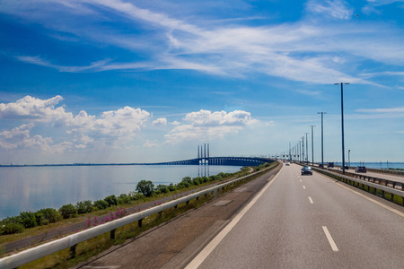 cable bridge: Traffic on the great belt bridge in Denmark in a summer day Stock Photo