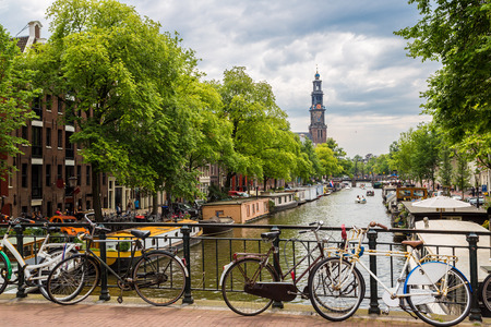 Bicycles on a bridge over the canals of Amsterdam in a summer day