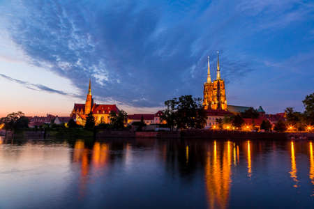 A cityscape cathedral, river Odra. Wroclaw, Poland, at dusk photo