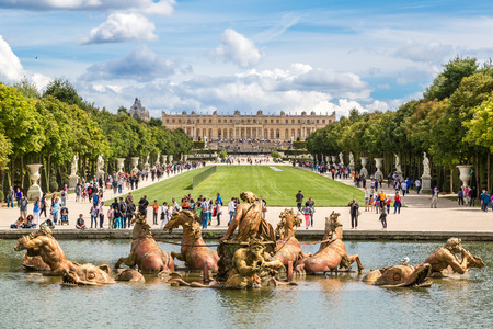 Fountain of Apollo in garden of Versailles Palace in a beautful summer day in France. Editorial