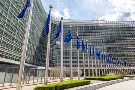 commission: European flags in front of  headquarters of European commission in Brussels in summer day