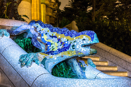 Sculpture of a salamandra of Antoni Gaudi  in the park Guell in Barcelona, Spain in a summer night