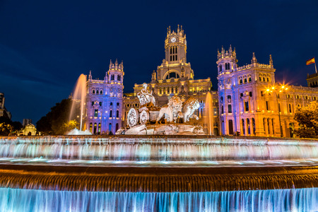 flag of spain: Cibeles fountain at Plaza de Cibeles in Madrid in a beautiful summer night, Spain Stock Photo