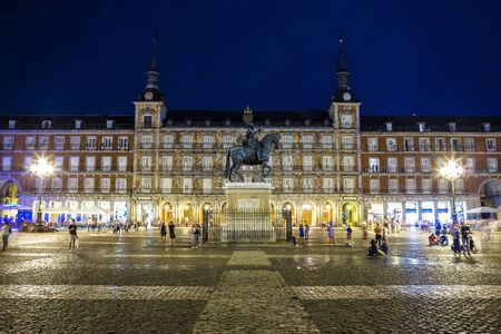 Statue of Philip III at Mayor plaza in Madrid in a beautiful summer night, Spain