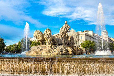 Cibeles fountain at Plaza de Cibeles in Madrid in a beautiful summer day, Spain