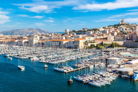 sea port: Aerial panoramic view on basilica of Notre Dame de la Garde and old port  in Marseille, France Stock Photo