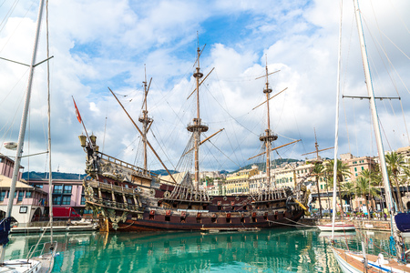 deck cannon: Galeone old wooden ship in a summer day in Genoa, Italy Stock Photo