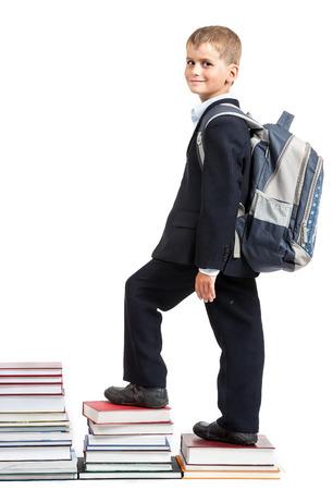niños saliendo de la escuela: Educación éxito gráfico - colegial exitoso aislado sobre fondo blanco. De vuelta a la escuela Foto de archivo