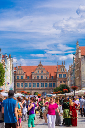 notable: GDANSK, POLAND - APRIL 01: People visitors Long Street on April 1, 2014 in Gdansk, Poland. Street is one of the most notable tourist attractions of the city.