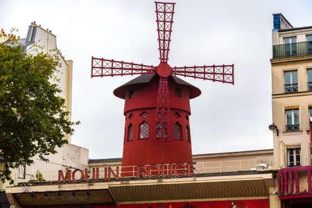 moulin: PARIS, FRANCE - JULY 14 2014: Moulin Rouge is the most famous cabaret in Paris, July 14, 2014