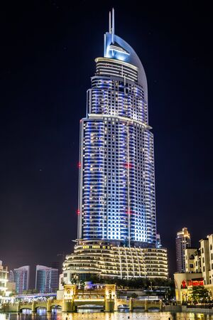 lavish: DUBAI, UAE - NOVEMBER 13: Address Hotel and Lake Burj Dubai in Dubai. The hotel is 63 stories high and feature 196 lavish rooms and 626 serviced residences, taken on 13 November 2013 in Dubai.
