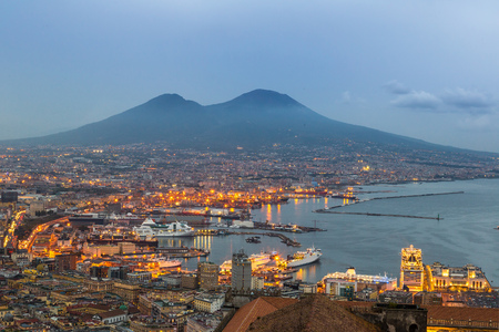 Napoli (Naples) and mount Vesuvius in the background at sunset in a summer day, Italy, Campania Reklamní fotografie - 44553508