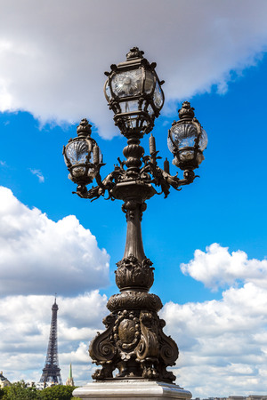 alexandre: Statue on  the Pont Alexandre III with eiffel tower in background in a beautiful summer day in Paris, France Stock Photo