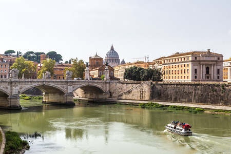 pietro: San Pietro basilica  and Sant angelo bridge in a summer day in Rome, Italy