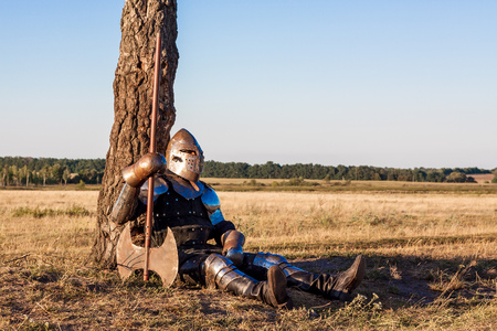 medieval warrior: Medieval knight in the field with an axe Stock Photo