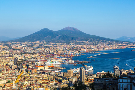 italy: Napoli (Naples) and mount Vesuvius in the background at sunset in a summer day, Italy, Campania