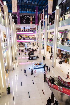 customer records: DUBAI, UAE - NOVEMBER 14: Shoppers at Dubai Mall on November 14, 2012 in Dubai. At over 12 million sq ft, it is the worlds largest shopping mall based on total area and 6th largest by gross leasable area. Editorial