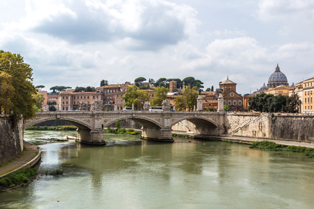 angelo: San Pietro basilica  and Sant angelo bridge in a summer day in Rome, Italy