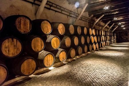 wooden barrel: Barrels in the wine cellar in Porto in Portugal