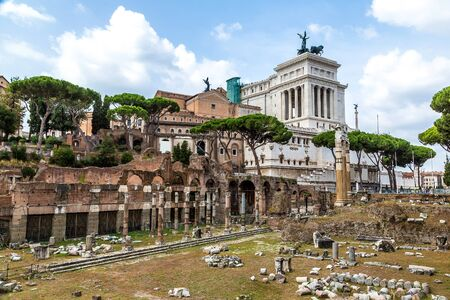 emmanuel: Ancient ruins of Forum and Victor Emmanuel II monument in a summer day in Rome, Italy