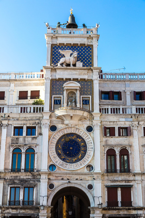 clocktower: Astronomical clock tower with signs in a summer day in Venice, Italy