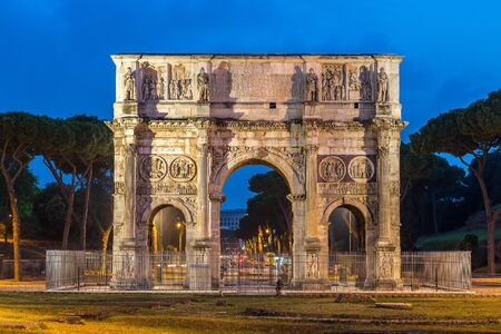 column arch: The Arch of Constantine in a summer night in Rome, Italy