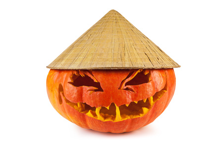 Halloween pumpkin with Asian conical hat isolated on a white background Stock Photo