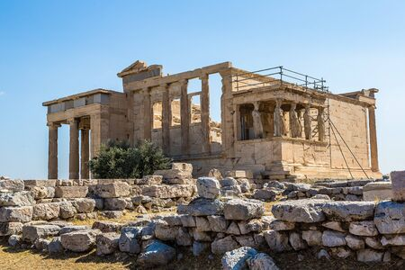 caryatids: Erechtheum temple ruins on the Acropolis in a summer day in Athens, Greece