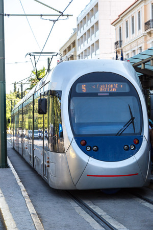 electric tram: Modern electric tram in Athens, Greece in a summer day Editorial