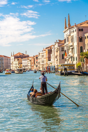 venice canal: Gondola on Canal Grande in Venice, in a beautiful summer day in Italy Stock Photo