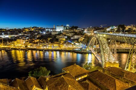 luis: Panoramic view of Porto and the Dom Luiz bridge in Portugal at night Stock Photo