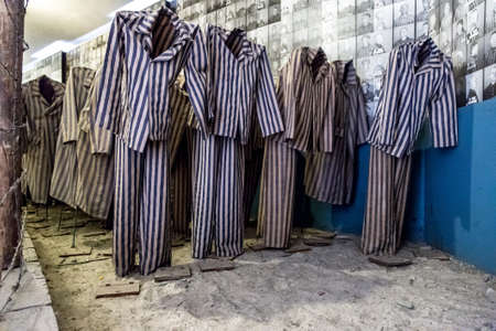 auschwitz memorial: OSWIECIM, POLAND - JULY 22: Exhibition with prisoners clothes in Auschwitz. It is the biggest nazi concentration camp in Europe on July 22, 2014 in Oswiecim, Poland Editorial