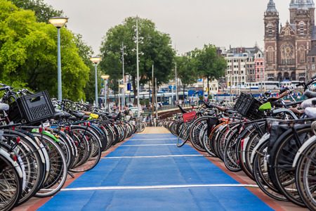 bicycle: Huge bicycle parking in the center of Amsterdam  in a summer day