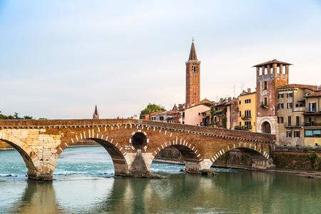 Ponte di Pietra. Bridge in Verona in a summer day, Italy,