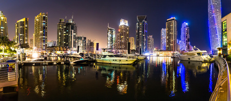 marina bay: Dubai downtown night scene with city lights, luxury new high tech town in middle East. Dubai Marina cityscape, UAE.