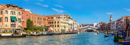 rialto: Gondola at the Rialto bridge in Venice, in a beautiful summer day in Italy Editorial