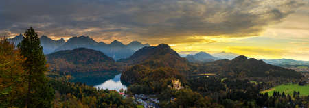 neuschwanstein: Alps and lakes at sunset in Germany. Taken from the hill next to  Neuschwanstein castle.
