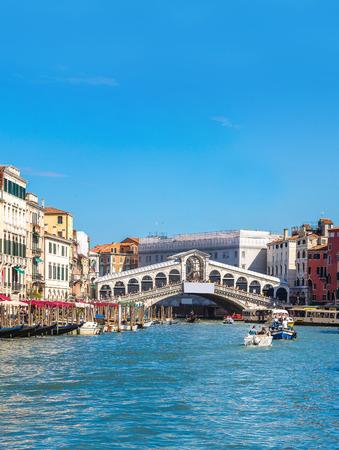 rialto: Gondola at the Rialto bridge in Venice, in a beautiful summer day in Italy Stock Photo