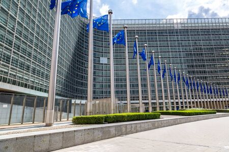 belgium: European flags in front of  headquarters of European commission in Brussels in summer day